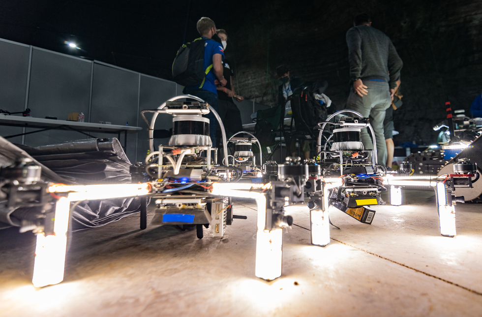 Drones sitting on the ground with very bright lights